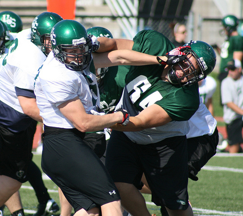 Defensive lineman Joel Seutter tangles with offensive lineman Mike Fuller.