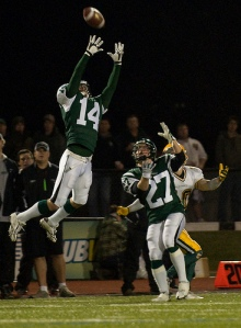 Jon Krahenbil goes up for one of six Huskies interceptions on the night